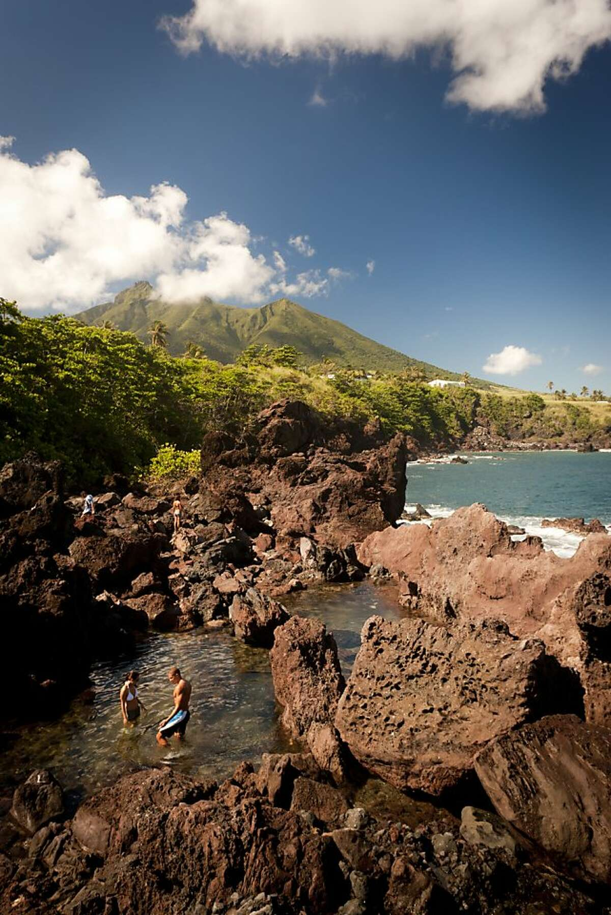 St. Kitts has undulating mountains draped in green and is ringed with sun-bleached beaches.