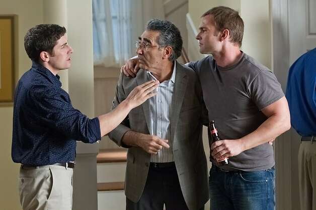 "(L to R) Jim (JASON BIGGS), Jim's Dad (EUGENE LEVY) and Stifler (SEANN WILLIAM SCOTT) tie one on in ""American Reunion"". In the comedy, all the ""American Pie"" characters we met a little more than a decade ago return to East Great Falls for their high-school reunion. Photo: Hopper Stone, Universal Pictures"
