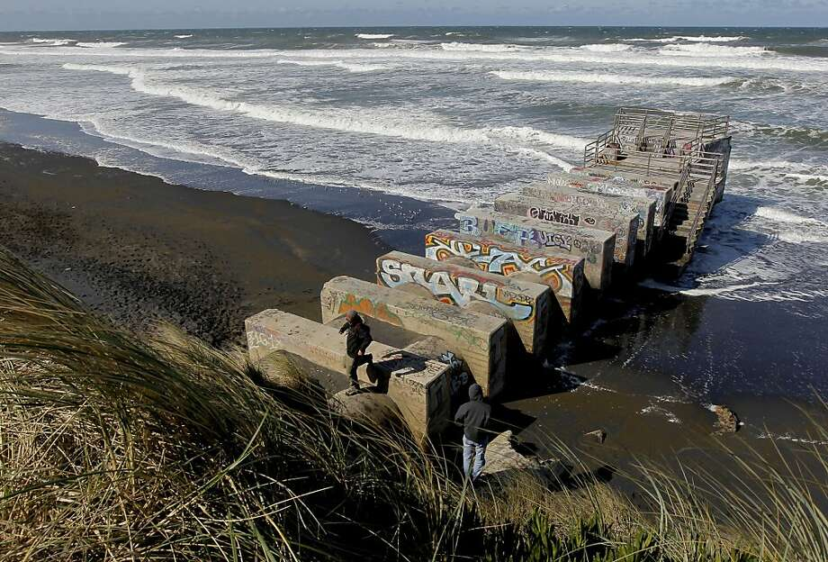 The Westside Transport Box, a storm water overflow container, stretches into the surf. Photo: Michael Macor, The Chronicle