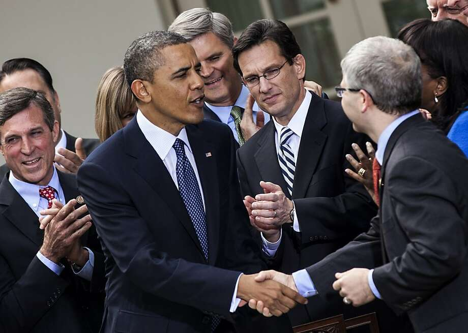 President Obama shakes hands with Rep. Patrick McHenry, R-N.C, after signing the Jobs Act in April. Photo: Brendan Smialowski, AFP/Getty Images