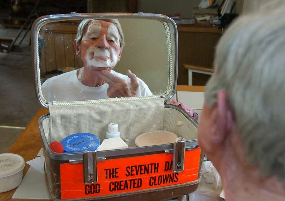 "In this March 29, 2012, photo, Floyd ""Creeky"" Creekmore puts on his makeup before a performance in Billings, Mont. Guinness World Records has anointed the world's oldest performing clown, and it's none other than Creekmore, a former Montana rancher who's been donning the big nose and bright makeup for almost eight decades. (AP Photo/Matthew Brown) Photo: Matthew Brown, Associated Press"