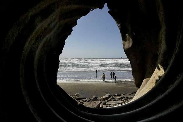 An abandoned drainage pipe sits exposed jetting from the eroded cliff, in San Francisco, Ca., on Thursday April 5, 2012, at the parking lot at Sloat and the Great Highway along Ocean Beach. Ocean Beach draws more than 300,000 surfers, cyclists and visitors annually, making it one of San Francisco's most beloved natural open spaces. It will also be the city's first real test in responding to the effects of climate change. By 2050, the sea level will rise 14 inches, meaning the coast and the major wastewater and stormwater infrstructure embedded into it  will be seriously eroded. A new plan from the San Francisco Planning Urban and Research Association, the final version of which will be released in April, lays out a long-term vision for the area. Photo: Michael Macor, The Chronicle