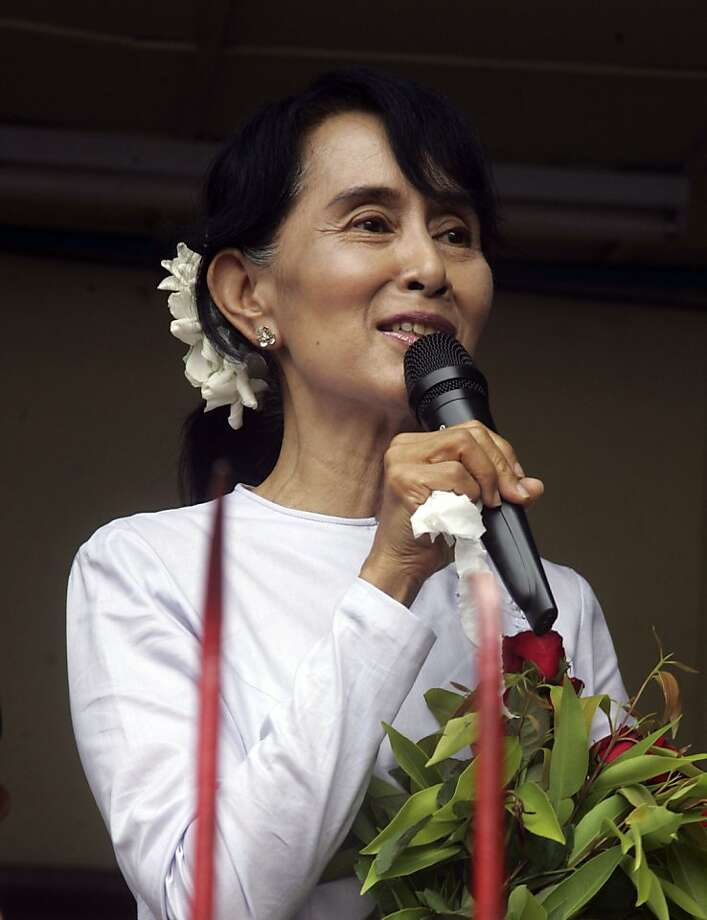 Myanmar pro-democracy leader Aung San Suu Kyi talks to supporters at the headquarters of her National League for Democracy party in Yangon, Myanmar Monday, April 2, 2012. Suu Kyi claimed victory Monday in Myanmar's historic by-election, saying she hoped it will mark the beginning of a new era for the long-repressed country. (AP Photo/Khin Maung Win) Photo: Khin Maung Win, Associated Press