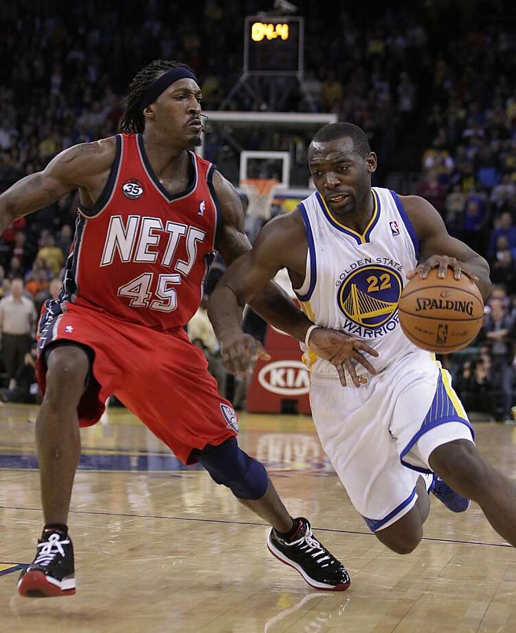 New Jersey Nets' Gerald Wallace, left, guards Golden State Warriors' Charles Jenkins (22) during the second half of an NBA basketball game Friday, March 30, 2012, in Oakland, Calif. (AP Photo/Ben Margot) Photo: Ben Margot, Associated Press