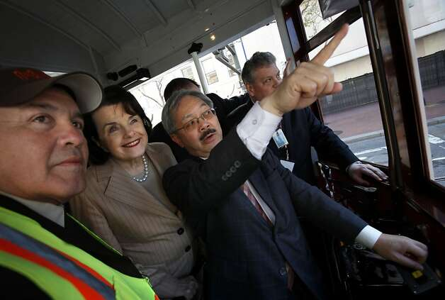 San Francisco Mayor Ed Lee points out sights along Market Street to Sen. Dianne Feinstein, D-Calif., with the help of Muni operator Angel Carvajal (left) during an April tour marking Muni's 100th birthday. Photo: Sarah Rice, Special To The Chronicle