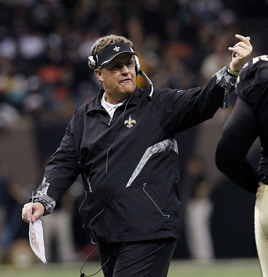 "FILE - In this Dec. 12, 2010 file photo, New Orleans Saints defensive coordinator Gregg Williams gestures in the second half of an NFL football game aainst the St. Louis Rams, in New Orleans. A newly released recording purports to capture former Saints defensive coordinator Williams telling players to ""put a lick"" on San Francisco's Kyle Williams to see if the receiver has lingering effects from an earlier concussion. (AP Photo/Gerald Herbert, File) Photo: Gerald Herbert, Associated Press"
