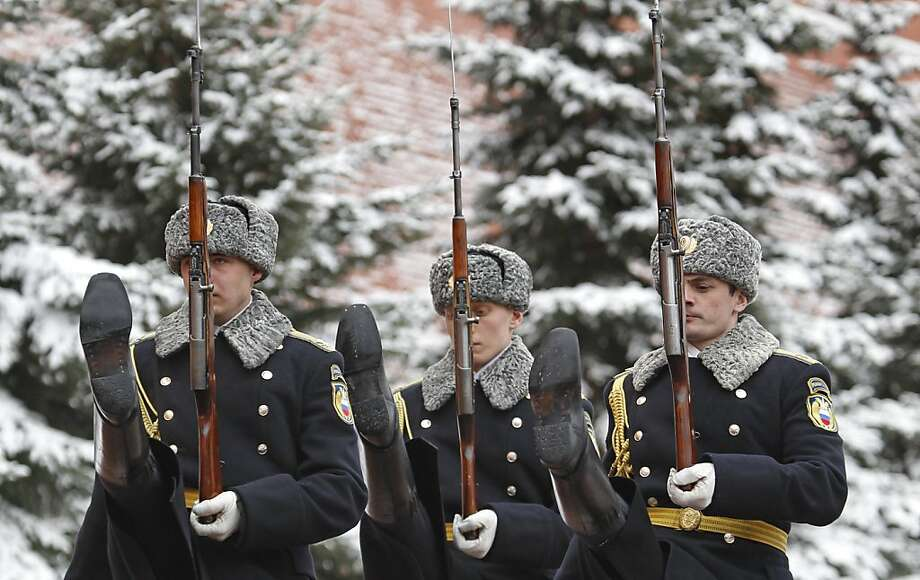 Kremlin guards march near the Tomb of Unknown soldier, beside Moscow's Kremlin, Thursday, April 5, 2012. Moscow was hit by a heavy snow storm and strong wind Thursday morning. (AP Photo/Mikhail Metzel) Photo: Mikhail Metzel, Associated Press