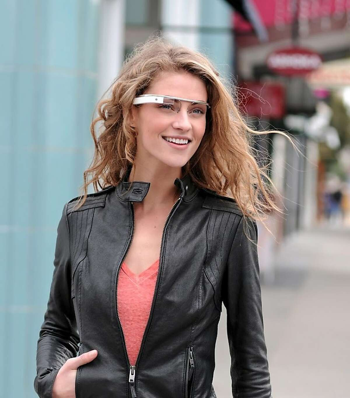 """In this undated handout photo provided by the Google[x] group's """"Project Glass"""", an early prototype of Google's futuristic Internet-connected glasses, are modeled. The specs are said to give you directions, let you video chat, shop and do everything else you now need a handheld gadget to accomplish. Google gave a glimpse of """"Project Glass"""" in a video and blog post this week. (AP Photo/Google)"""