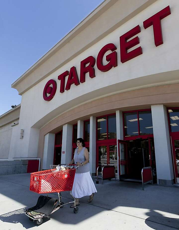 In this Tuesday, July 16, 2011 photo, an unidentified customer shops at Target Eagle Rock store in Los Angeles. Retailers from discounter Target Corp. to depart-store chain Macy's to outdoor sports retailer Zumiez reported better-than-expected sales during the month of March in the latest sign that Americans are feeling better about the economy.  (AP Photo/Damian Dovarganes) Photo: Damian Dovarganes, Associated Press