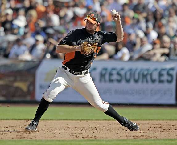 San Francisco Giants first baseman Brandon Belt in aciton against the Seattle Mariners during a spring training baseball game Sunday, March 11, 2012 in Scottsdale, Ariz. (AP Photo/Marcio Jose Sanchez) Photo: Marcio Jose Sanchez, Associated Press