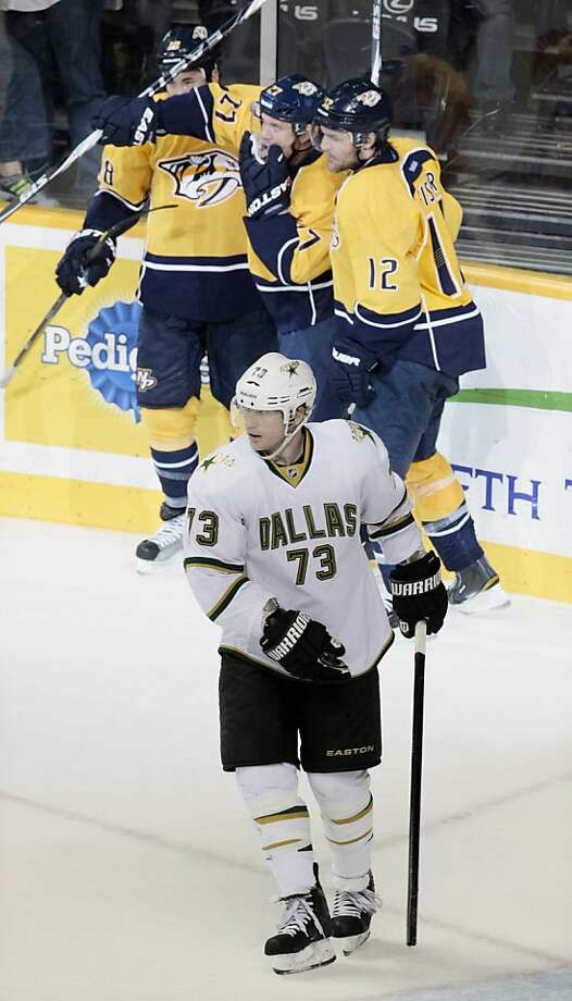 Dallas Stars right wing Michael Ryder (73) skates away as Nashville Predators right wing Patric Hornqvist (27), of Sweden, celebrates with Mike Fisher (12) and Brandon Yip (18) after Hornqvist scored in the third period of an NHL hockey game Thursday, April 5, 2012, in Nashville, Tenn. The Predators won 2-0. (AP Photo/Mark Humphrey) Photo: Mark Humphrey, Associated Press