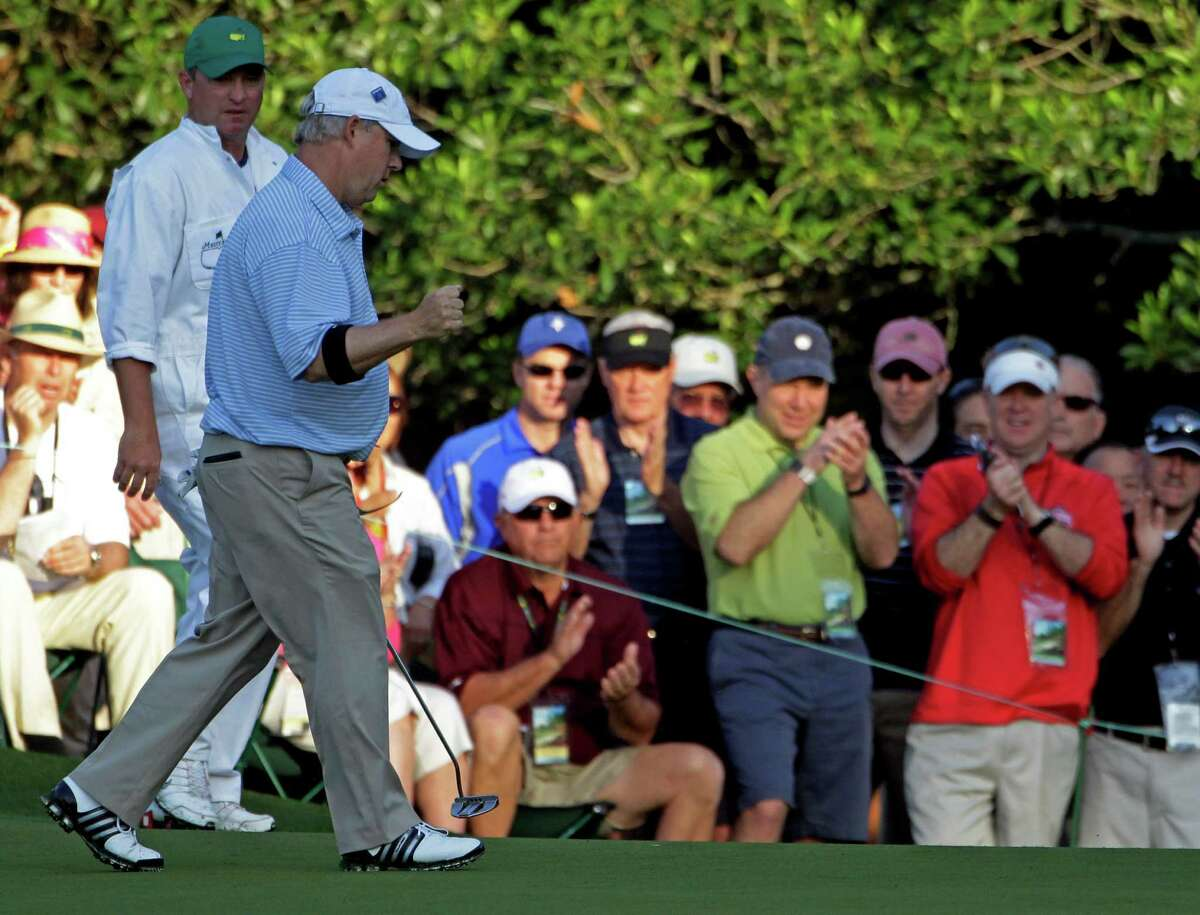 Amateur Randal Lewis pumps his fist after making par on the first hole during the first round of the Masters golf tournament Thursday, April 5, 2012, in Augusta, Ga. (AP Photo/Darron Cummings)
