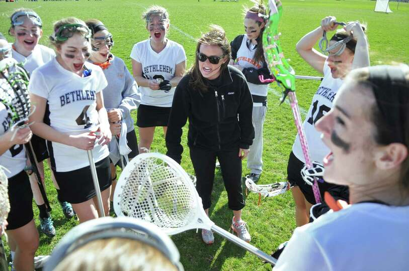 Bethlehem lacrosse coach Tee Ladouceur, center, talks to her team before the start of their 18-2 vic