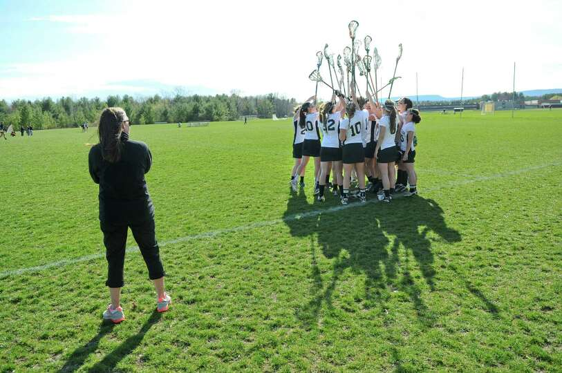 Bethlehem lacrosse coach Tee Ladouceur, left, with her team before the start of their 18-2 victory o