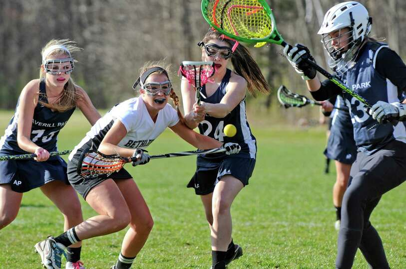 Bethlehem's Abby Seymour, second from left, , is defended by Averill Park's Emily Halpin, left, and