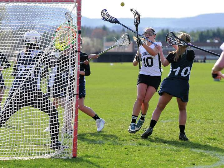 Bethlehem lacrosse player Abby Seymour, #10, scores a goal against Averill Park goalie Jackie St. Pi