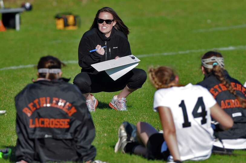 Bethlehem lacrosse coach Tee Ladouceur, center, talks to her during halftime of their 18-2 victory o