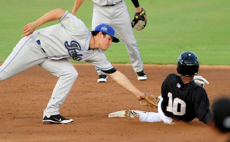 San Antonio's Jeudy Valdez (10) is tagged out at second base by Tulsa's Nolan Arenado during Texas League baseball action at Wolff Stadium on Thursday, April 5, 2012. Valdez was trying to get to second on a throwing error to first base. Photo: BILLY CALZADA, San Antonio Express-News / SAN ANTONIO EXPRESS-NEWS