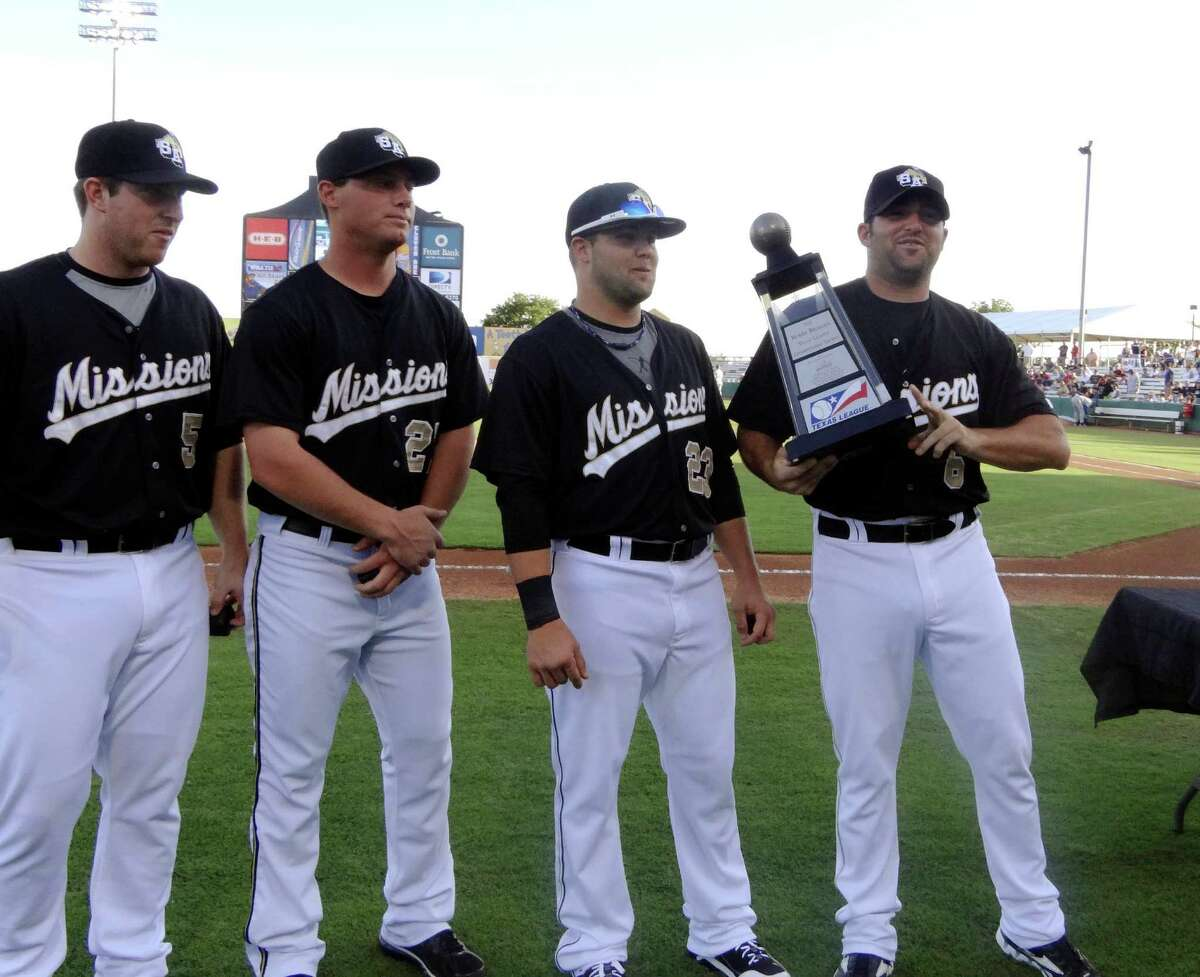 Cody Decker, right, and other members of last year's Texas League Champions, the San Antonio Missions, are presented their championship trophy prior to their home opener against the Tulsa Drillers at Wolff Stadium on Thursday, April 5, 2012.