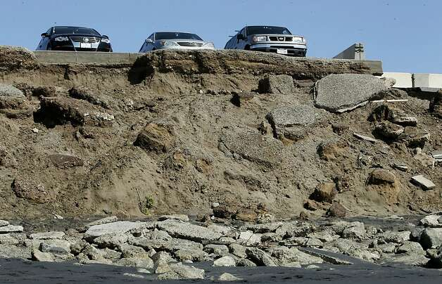 Cars parked at the edge of the lot at Sloat and the Great Highway along Ocean Beach, in San Francisco, Ca., on Thursday April 5, 2012, which has slowly been eroding onto the beach below. Ocean Beach draws more than 300,000 surfers, cyclists and visitors annually, making it one of San Francisco's most beloved natural open spaces. It will also be the city's first real test in responding to the effects of climate change. By 2050, the sea level will rise 14 inches, meaning the coast and the major wastewater and stormwater infrstructure embedded into it  will be seriously eroded. A new plan from the San Francisco Planning Urban and Research Association, the final version of which will be released in April, lays out a long-term vision for the area. Photo: Michael Macor, The Chronicle