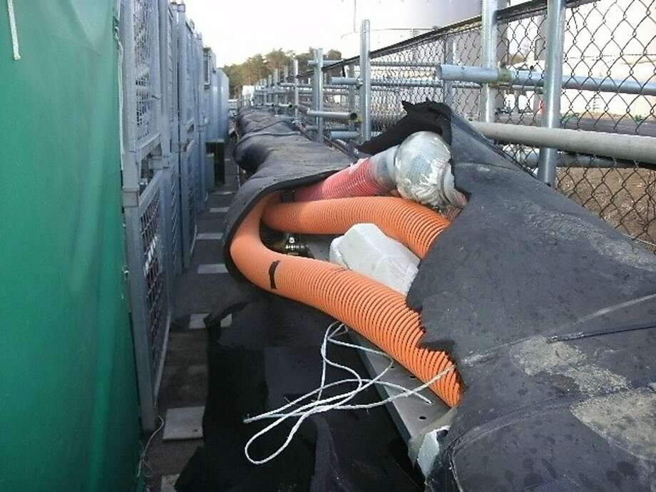 In this photo released by Tokyo Electric Power Co. (TEPCO), a section of a hose, top, from which tons of highly radioactive water appears to have leaked into the ocean, is seen covered with vinyl tape at the tsunami-hit Fukushima Dai-ichi nuclear plant in Okuma, Fukushima Prefecture, northeastern Japan, Thursday, April 5, 2012. The leak came as TEPCO, the operator of the nuclear plant, struggles to keep the melted reactors cool and contain radiation and raises concerns about its ability to keep the plant stable. Similar leaks have occurred several times since last year, and officials say they do not pose an immediate health threat. The company said it appeared to have stopped the leak. Photo: Associated Press