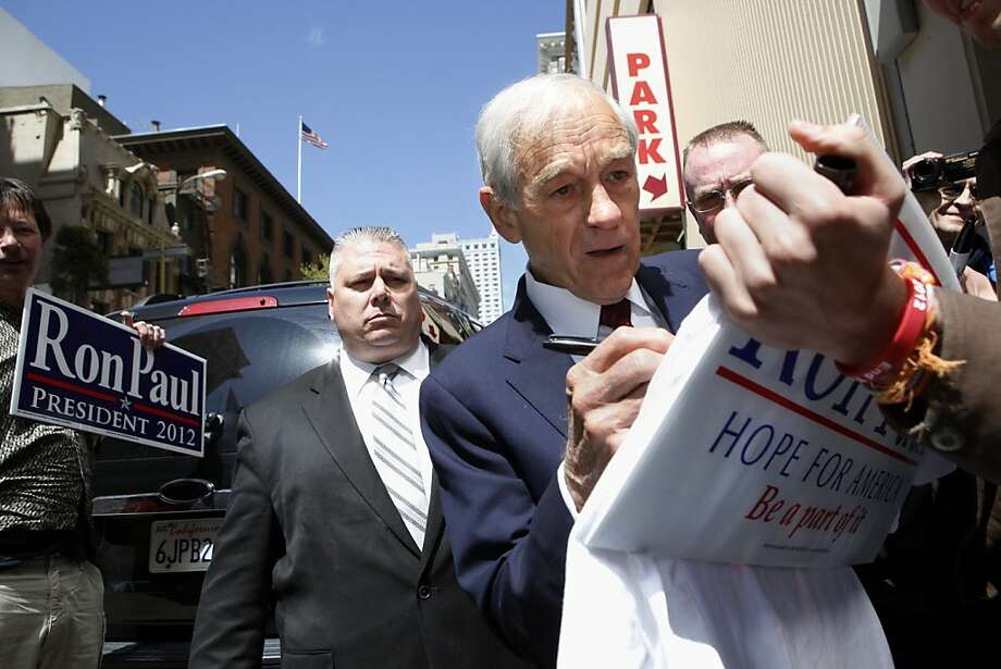 Republican presidential primary candidate Ron Paul signs a poster following a private fundraising luncheon at the Marriott Hotel on Thursday, April 5, 2011 in San Francisco, Calif. Photo: Beck Diefenbach, Special To The Chronicle