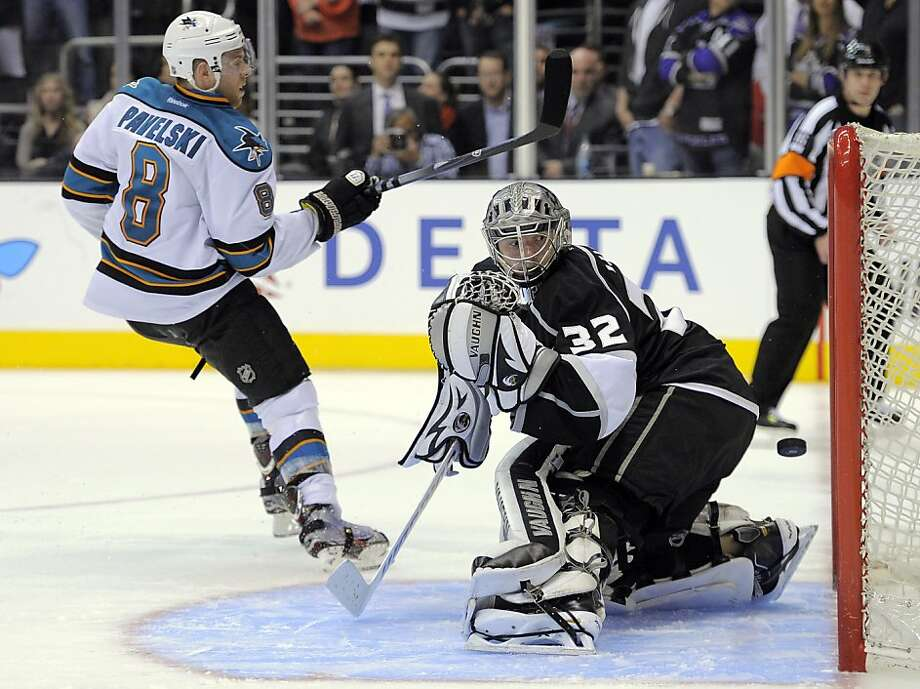 San Jose Sharks center Joe Pavelski (8) scores against Los Angeles Kings goalie Jonathan Quick (32) during an overtime shootout in their NHL hockey game, Thursday, April 5, 2012, in Los Angeles. The Sharks won 6-5. (AP Photo/Mark J. Terrill) Photo: Mark J. Terrill, Associated Press