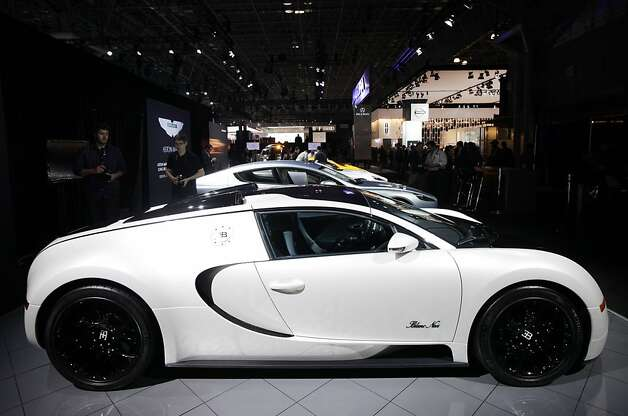 The Bugatti Veyron 16.4 Grand Sport is displayed, Wednesday, April 4, 2012 at the New York International Auto Show. The $1.9 million car is powered by a 16-cylinder, 1,000 horsepower engine to a top speed of 253 miles per hour (407 kilometers per hour).(AP Photo/Mark Lennihan) Photo: Mark Lennihan, Associated Press