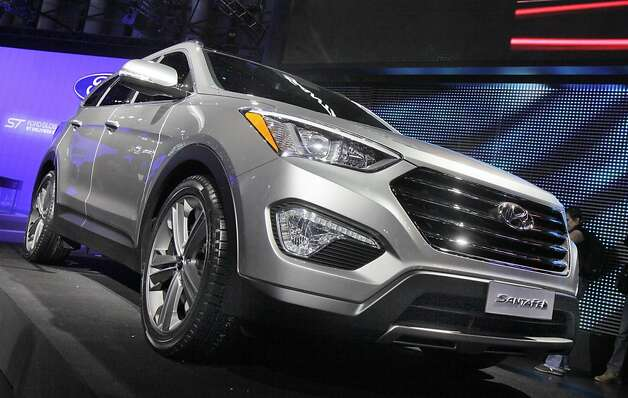 The 2013 Hyundai Santa Fe is unveiled at the New York International Auto Show, in New York's Javits Center,  Wednesday, April 4, 2012. (AP Photo/Richard Drew) Photo: Richard Drew, Associated Press