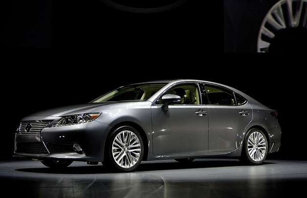 The Toyota Motor Corp. Lexus ES vehicle is unveiled during a news conference at the New York International Auto Show in New York, U.S., on Wednesday, April 4, 2012. The 2012 New York Auto Show is open to the public April 6-15. Photographer: Scott Eells/Bloomberg Photo: Scott Eells, Bloomberg