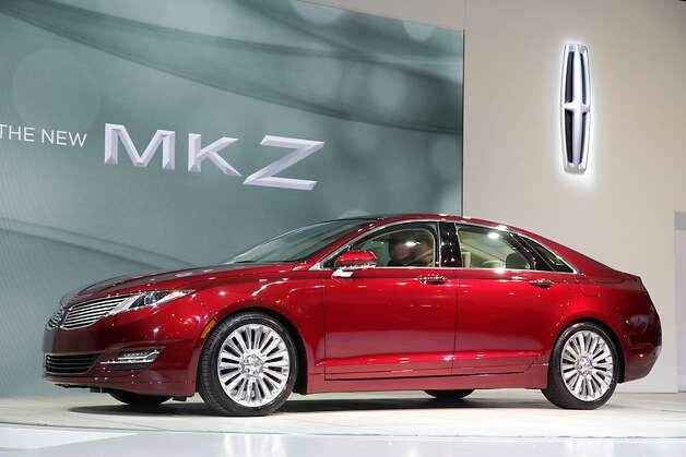 The 2013 Lincoln MKZ 2.0 liter gas electric hybrid is displayed, Wednesday, April 4, 2012 at the New York International Auto Show. (AP Photo/Mark Lennihan) Photo: Mark Lennihan, Associated Press