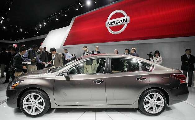 A crowd gathers around a 2013 Nissan Altima 3.5 SL sedan, Wednesday, April 4, 2012 at the New York International Auto Show. (AP Photo/Mark Lennihan) Photo: Mark Lennihan, Associated Press