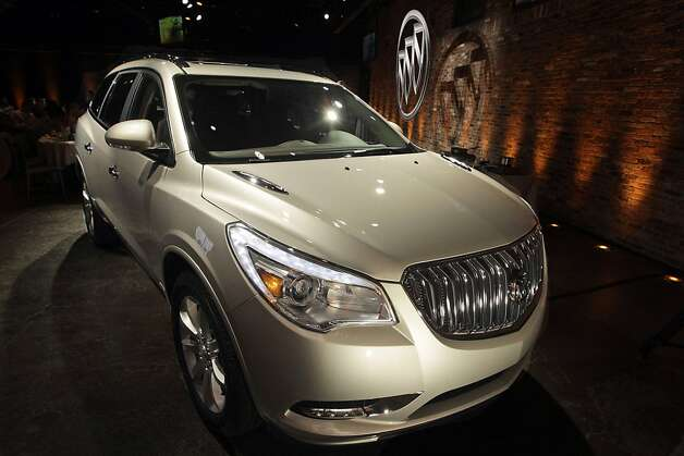 The 2013 Buick Enclave is unveiled at a news conference ahead of the New York International Car Show, Tuesday, April 3, 2012 in New York.  (AP Photo/Mary Altaffer) Photo: Mary Altaffer, Associated Press