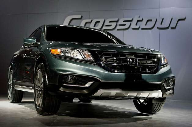 The Honda Motor Co. Crosstour is unveiled during a news conference at the New York International Auto Show in New York, U.S., on Wednesday, April 4th, 2012. The 2012 New York Auto Show is open to the public April 6-15. Photographer: Scott Eells/Bloomberg Photo: Scott Eells, Bloomberg