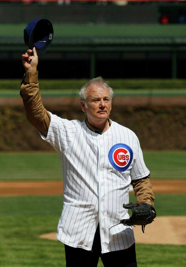 Actor Bill Murray waves to the crowd before throwing out a ceremonial first pitch before a opening day baseball game between the Chicago Cubs and the Washington Nationals Thursday, April 5, 2012, in Chicago. The Nationals won 2-1. Photo: AP