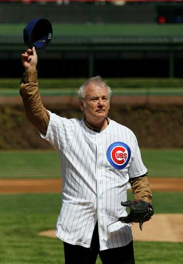 Actor Bill Murray waves to the crowd before throwing out a ceremonial first pitch before a opening d