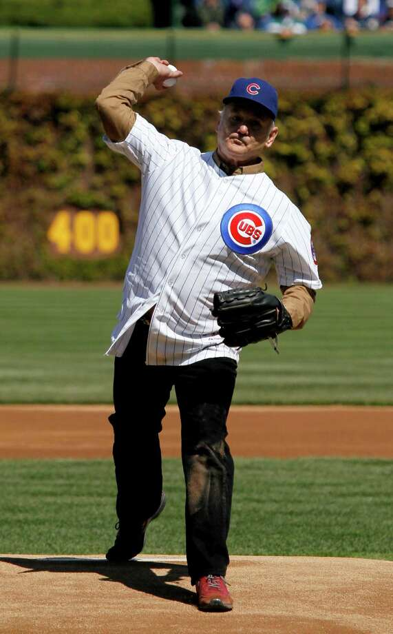 Actor Bill Murray throws out a ceremonial first pitch before an opening day baseball game between the Chicago Cubs and the Washington Nationals Thursday, April 5, 2012, in Chicago. The Nationals won 2-1. Photo: AP