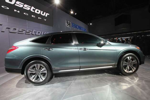 NEW YORK, NY - APRIL 04:   The new 2013 Honda Crosstour concept car is seen after being unveiled at the New York International Auto Show at the Jacob Javits Convention Center on April 4, 2012 in New York City. The New York International Auto Show features nearly 1,000 brand new vehicles from all auto industry sectors and is open to the public April 6-15. Photo: Mario Tama, Getty Images / 2012 Getty Images
