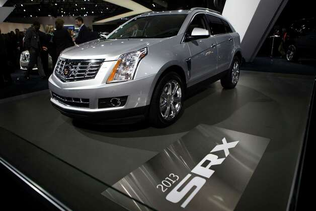 NEW YORK, NY - APRIL 05:  The 2013 Cadillac SRX is introduced at the 2012 New York International Auto Show on April 5, 2012 in New York City. The New York International Auto Show features nearly 1,000 brand new vehicles from all auto industry sectors and is open to the public April 6-15. Ê Photo: Andrew Burton, Getty Images / 2012 Getty Images