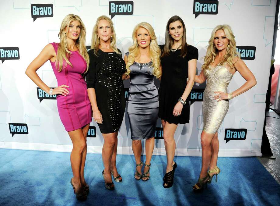 """Real Housewives of Orange County"" cast members, from left, Alexis Bellino, Vicki Gunvalson, Gretchen Rossi, Heather Dubrow and Tamra Barney attend the Bravo network 2012 upfront presentation on Wednesday, April 4, 2012 in New York. (AP Photo/Evan Agostini) Photo: Evan Agostini, Associated Press / AGOEV"