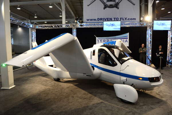 """The wings fold up in a demonstration of the Terrafugia """"Flying Car"""" during the first day of press previews at the New York International Automobile Show in New York."""