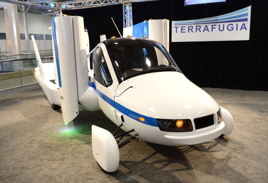 "The wings fold up in a demonstration of the Terrafugia ""Flying Car"" during the first day of press previews at the New York International Automobile Show. Photo: Getty Images"