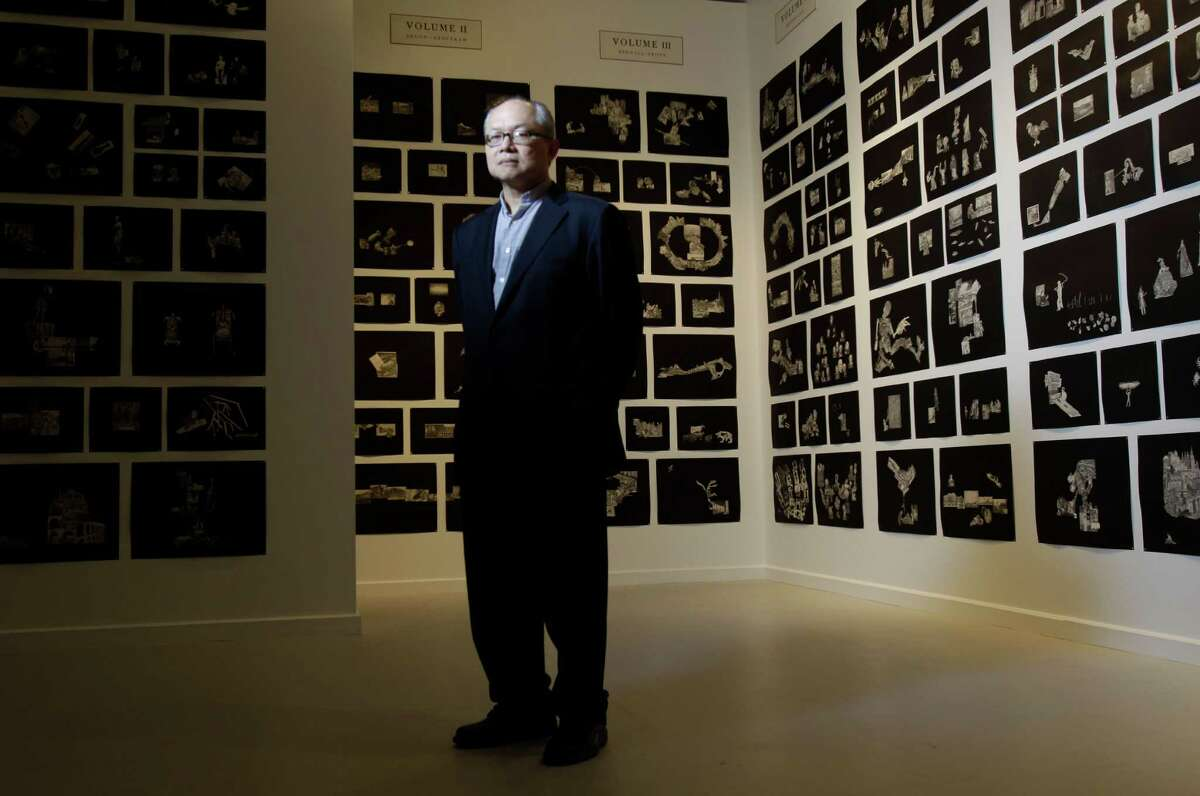 Artist Mel Chin poses among a portion of his exhibit at the Station Museum of Contemporary Art, 1502 Alabama, Saturday, March 17, 2012, in Houston. ( Melissa Phillip / Houston Chronicle )