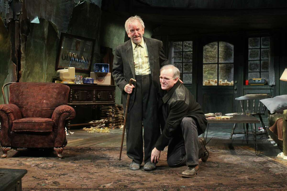 """John Tyson, left, and James Black play reunited Dublin brothers who join two drinking buddies and a mysterious stranger in a high-stakes poker game in Conor McPherson's """"The Seafarer."""""""