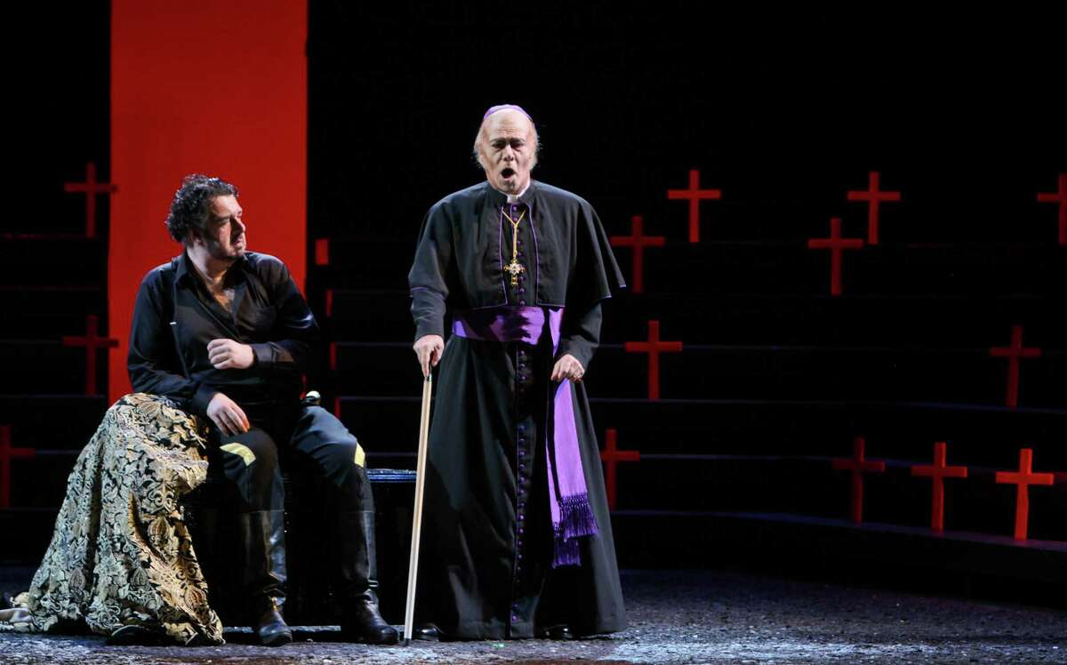 (For the Chronicle/Gary Fountain, April 2, 2012) Andrea Silvestrelli as Philippe II, left, and Samuel Ramey as The Grand Inquisitor, in this scene from Houston Grand Opera's production of Verdi's