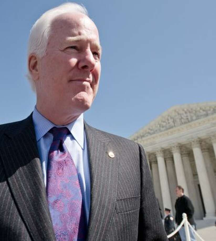 Sen. John Cornyn is interviewed after leaving the US Supreme Court in Washington, DC after the morning session March 27, 2012. (Karen Bleier / AFP/Getty Images)