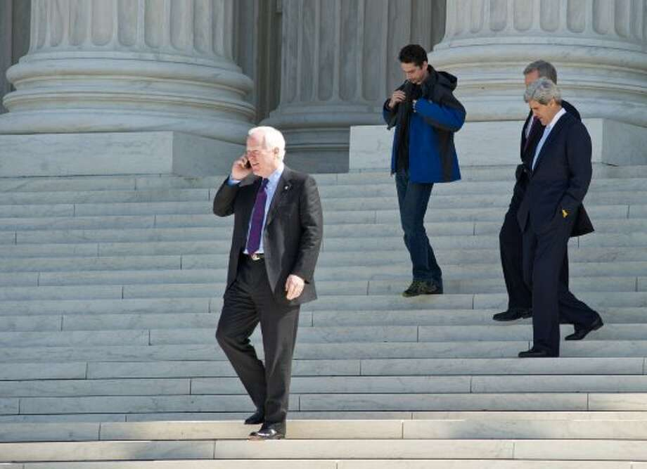 John Cornyn and John Kerry descend the steps of the US Supreme Court in Washington after the morning session on March 27, 2012. (Karen Bleier / Getty Images)