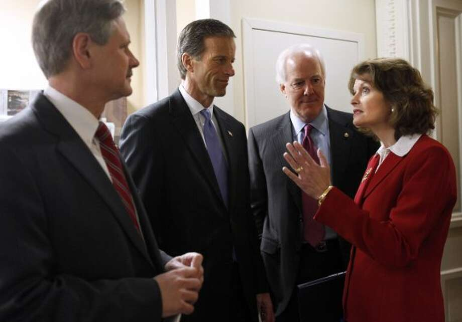 Sen. Lisa Murkowski, R-Alaska, talks to Texas Sen. John Cornyn, John Hoeven, R-N.D., and John Thune, R-S.D., prior to a news conference on gas prices on Capitol Hill in Washington on Feb. 29, 2012. (Jacquelyn Martin / The Associated Press)