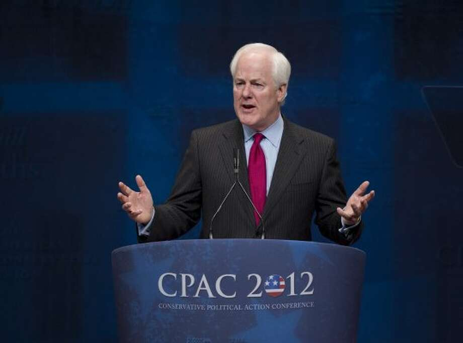 Sen. John Cornyn, R-Texas, criticizes U.S. Attorney General Eric Holder as he speaks to activists from America's political right at the Conservative Political Action Conference (CPAC) in Washington,  Saturday, Feb. 11, 2012. (J. Scott Applewhite / The Associated Press)