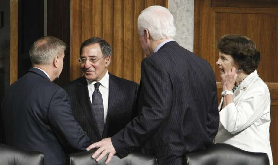 In this file photo, Defense Secretary of Defense nominee, CIA Director Leon Panetta, is greeted on Capitol Hill in Washington by Sen. John Cornyn as he arrived to testify before a Senate Armed Service Committee hearing on his nomination on June 9, 2011  (Manuel Balce Ceneta / The Associated Press)
